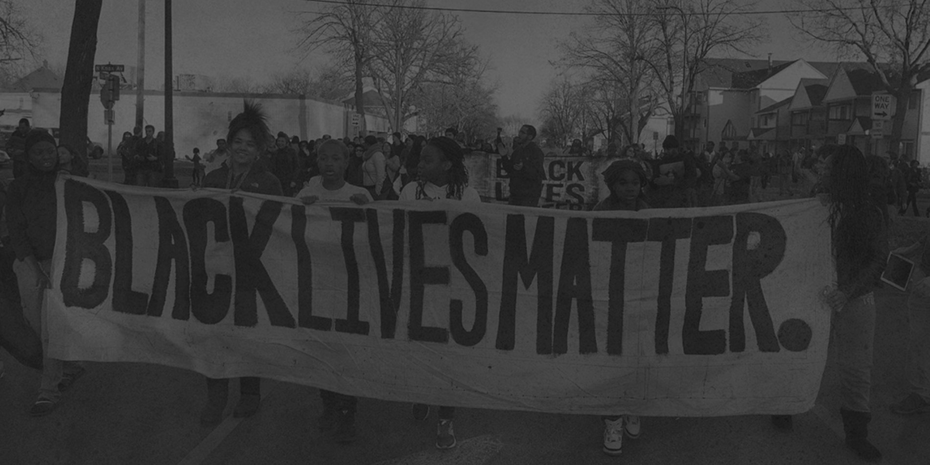 Tile image featuring a black and white image of a Black Lives Matter protest.
