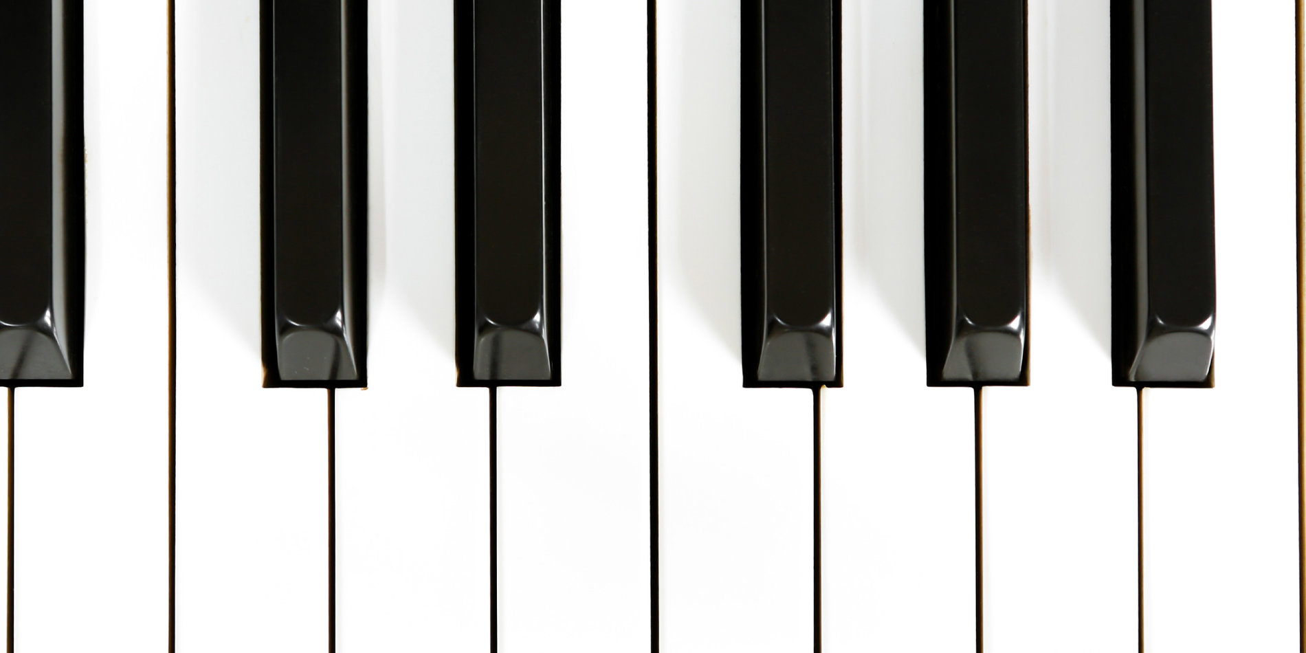 Banner image featuring a macro shot of piano keys, via Freepik through Student Affairs license.